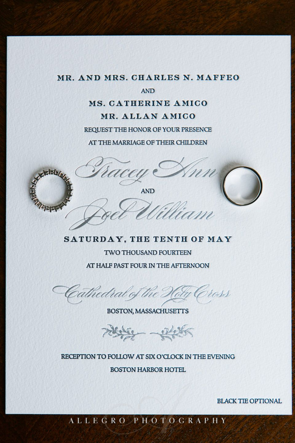 invitation with wedding ring- ring shot- photo by allegro photography