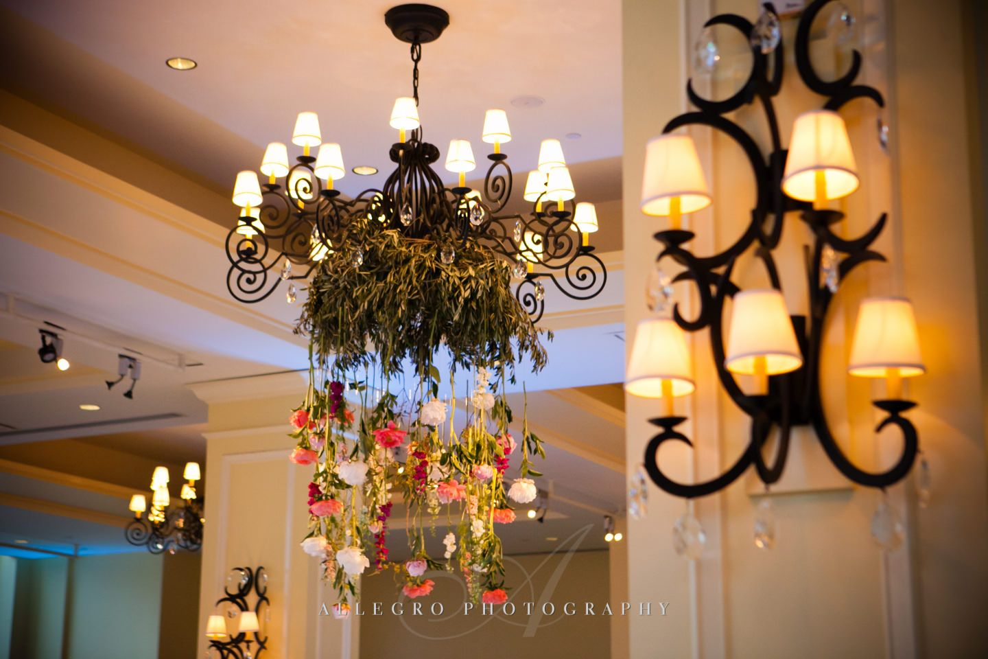 floral chandelier with pink white green peonies dripping down- photo by allegro photography