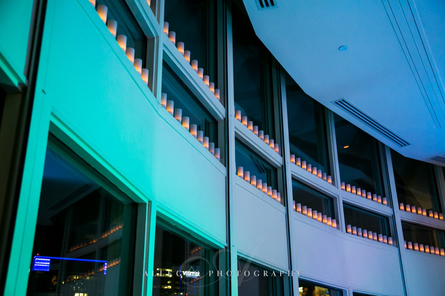candles along the windows and cool uplights at boston harbor hotel - photo by allegro photography