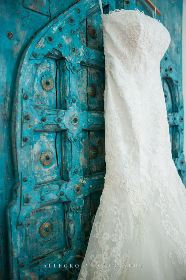 wedding dress and turquoise door - photo by Allegro Photography