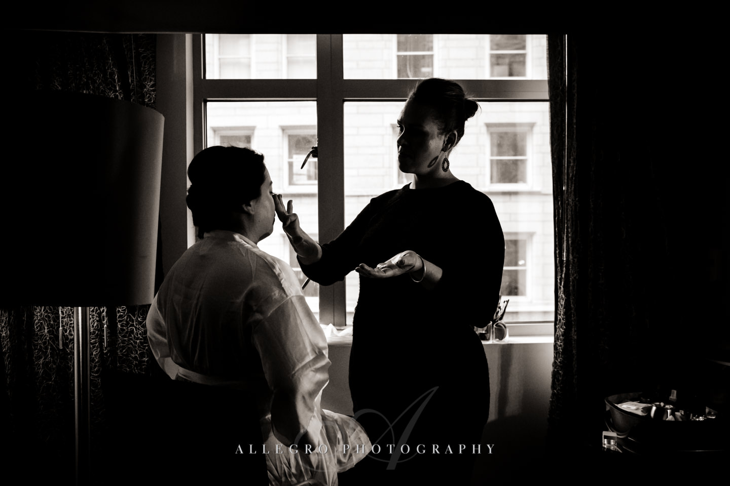 bride getting ready make-up at and hair at hotel nine zero -photo by allegro photography