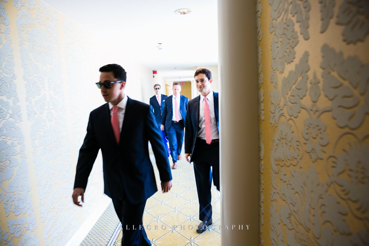 men walking at the four seasons hotel boston - photo by Allegro Photography