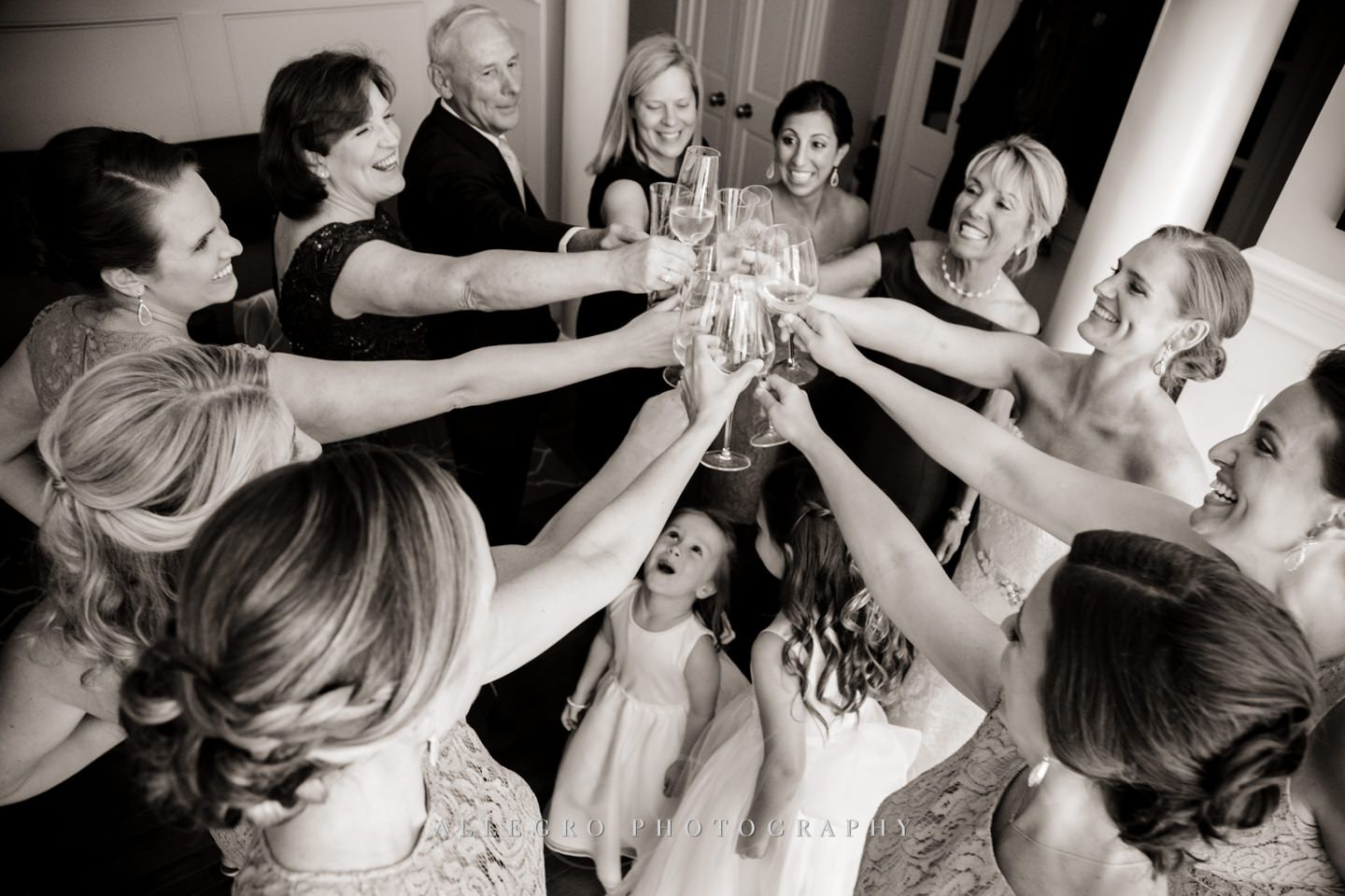 toast with flower girls in the mix - photo by Allegro Photography