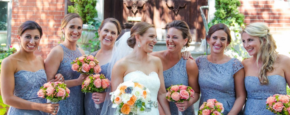 bride and bridesmaids portrait in front of home - photo by Allegro Photography