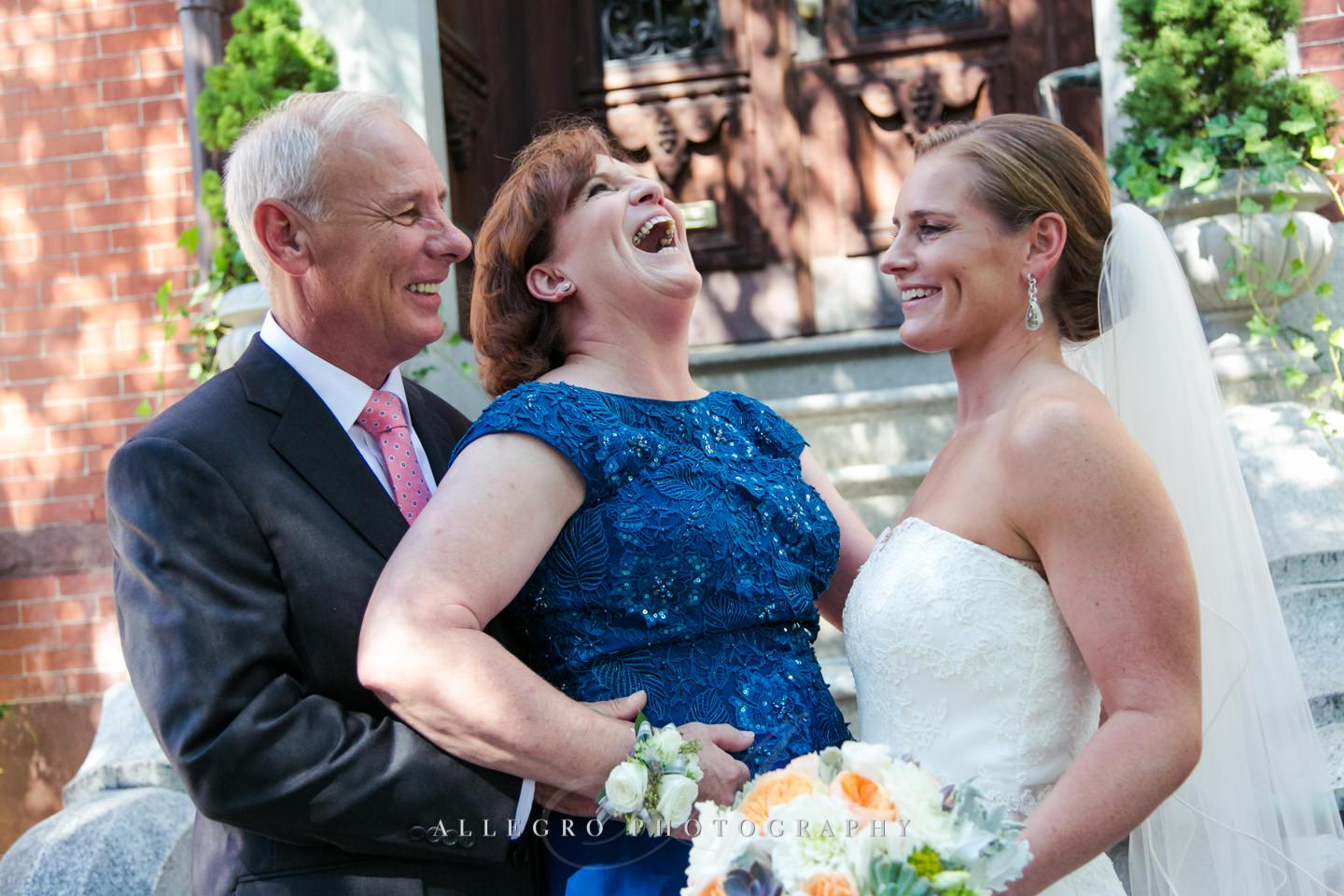bride with happy mother of the bride and father of the bride - photo by Allegro Photography