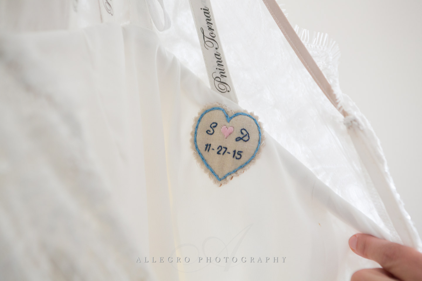 sewn in details with remembrance of wedding date -photo by Allegro Photography