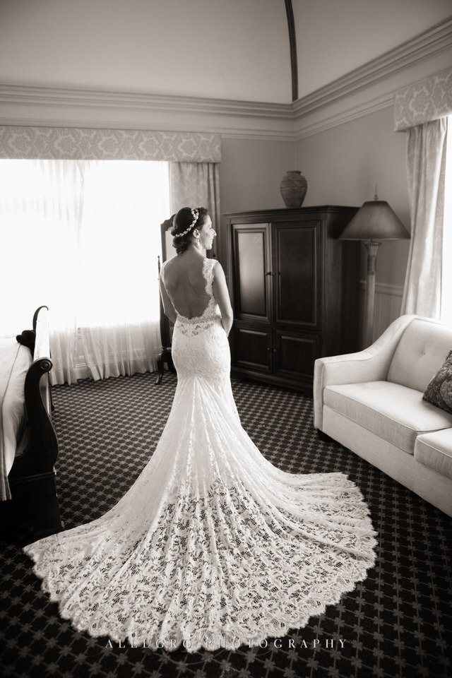 the bride is ready with her lace wedding gown and train- portrait -photo by Allegro Photography