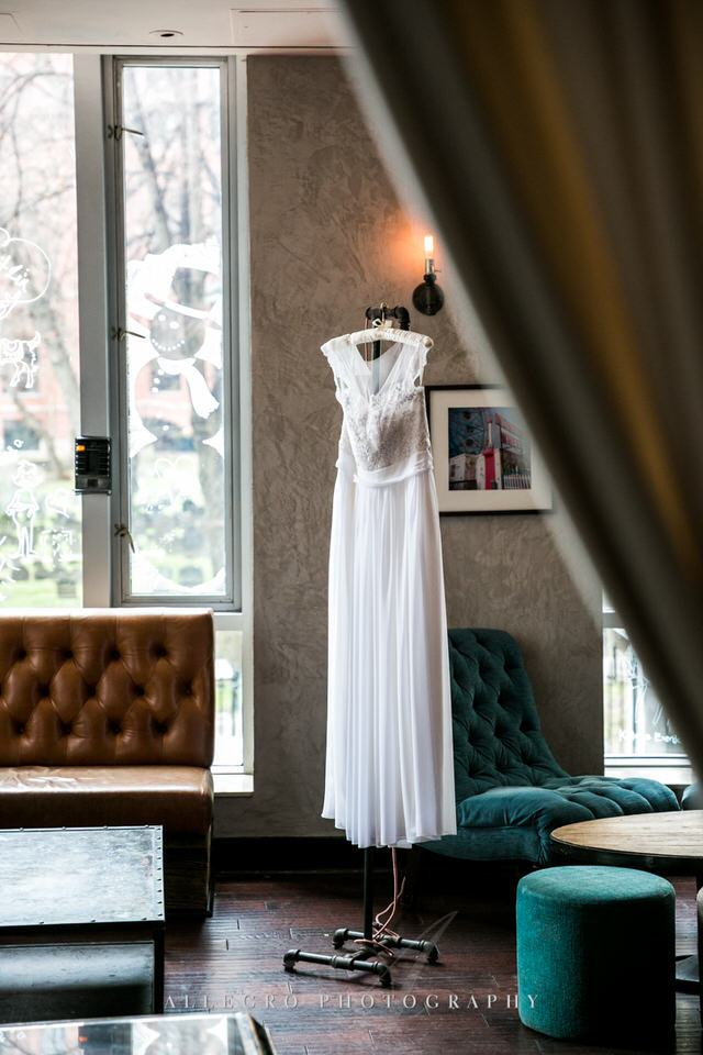 brides custom wedding gown at hotel nine zero bar -photo by allegro photography