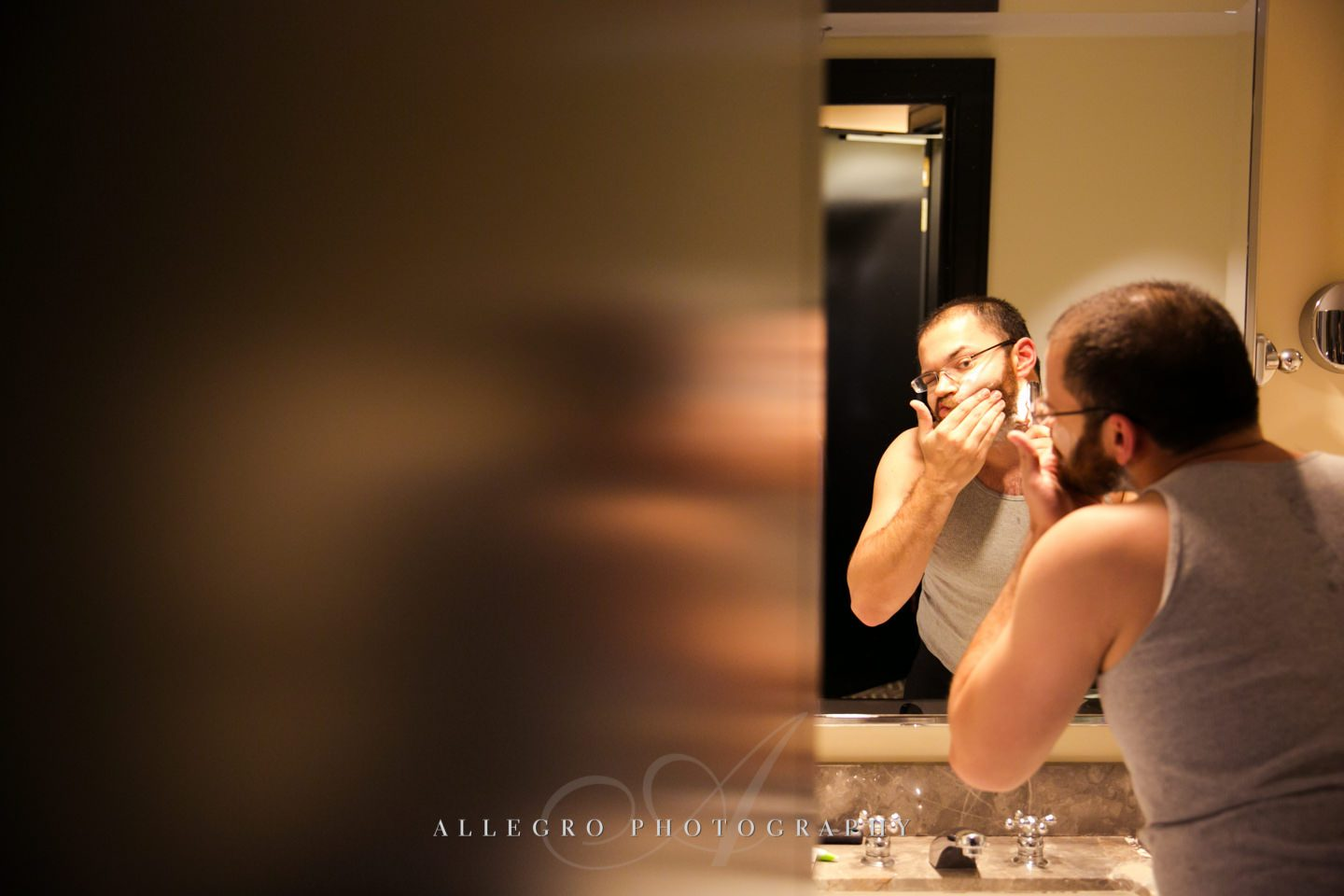 groomsman shave before the wedding  -photo by allegro photography