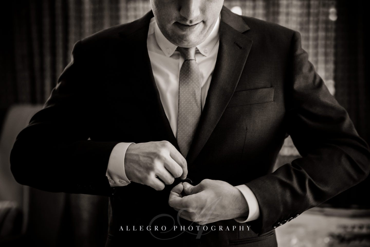 groom buttons up wedding prep -photo by allegro photography