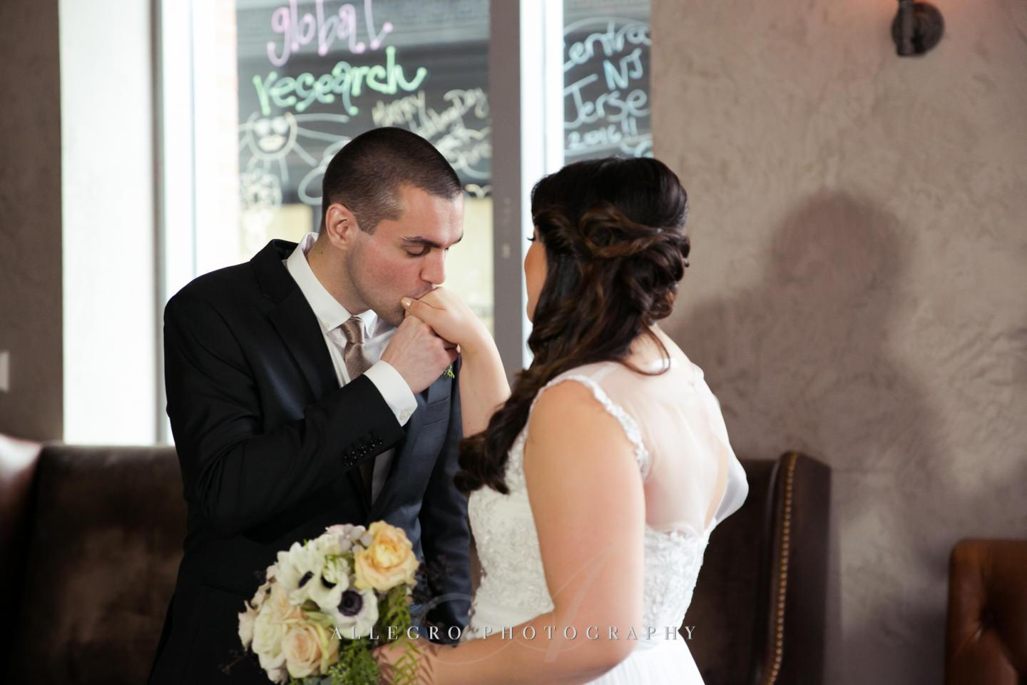 bride and groom kiss  -photo by Allegro Photography