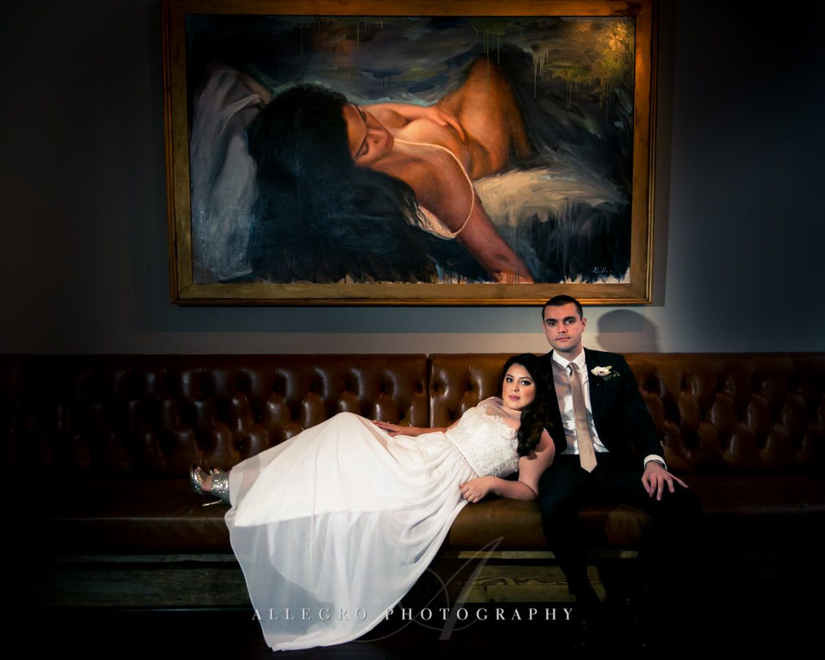 bride and groom painting portrait at high ball lounge hotel nine zero -photo by Allegro Photography