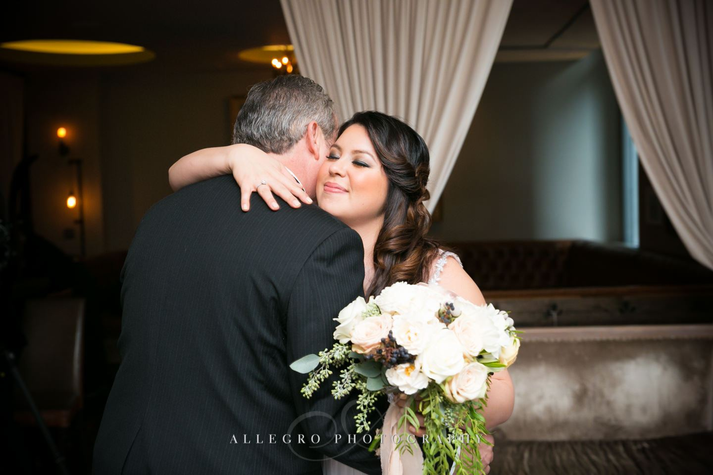 a hug from dad  -photo by Allegro Photography