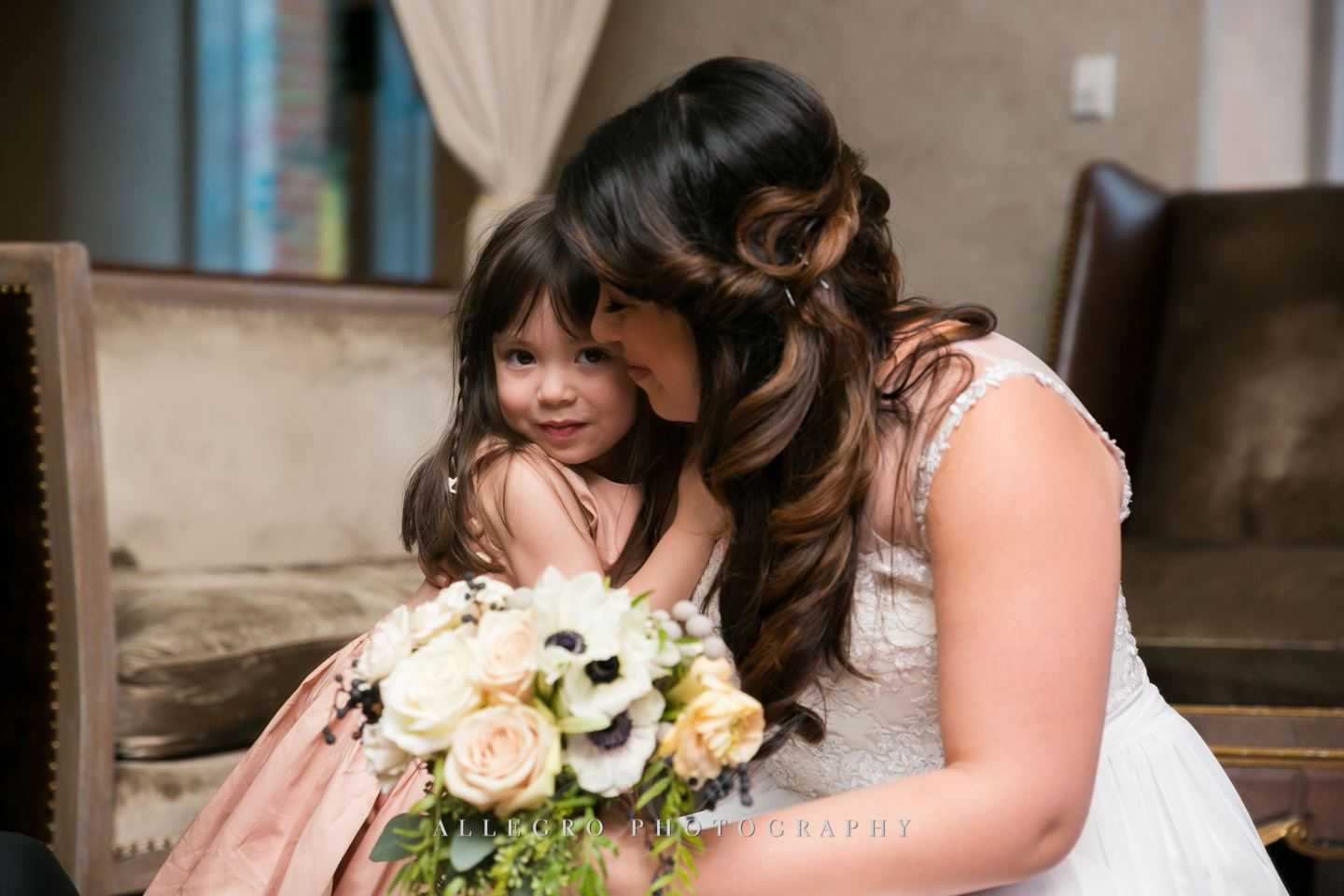 snuggles with the flower girl -photo by Allegro Photography