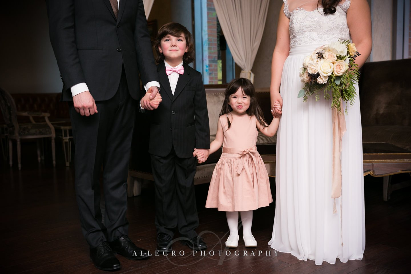 flower girl and ringbearer with the bride and groom -photo by Allegro Photography