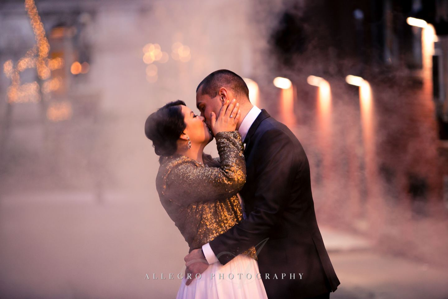 smokey bride and groom kiss in downtown boston -photo by Allegro Photography