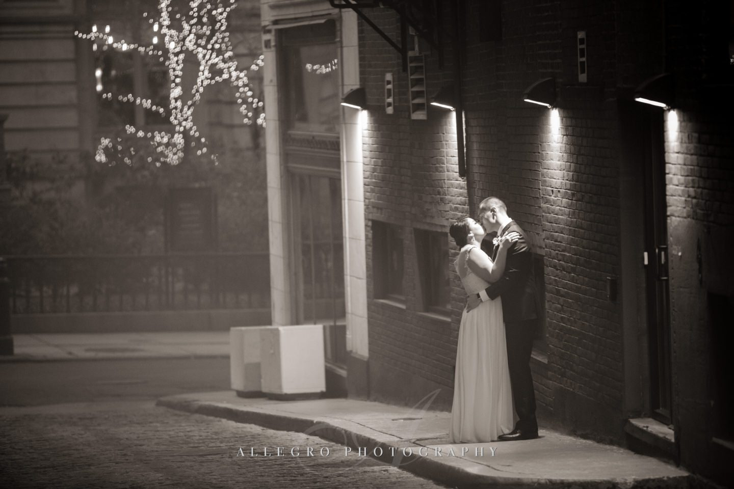 evening winter wedding bride and groom smokey kiss  -photo by Allegro Photography