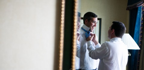 groom with bow tie - tieing it