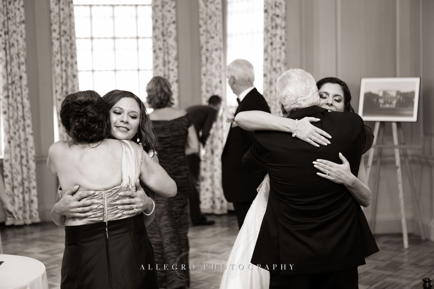 hugging parents of bride - photo by Allegro Photography