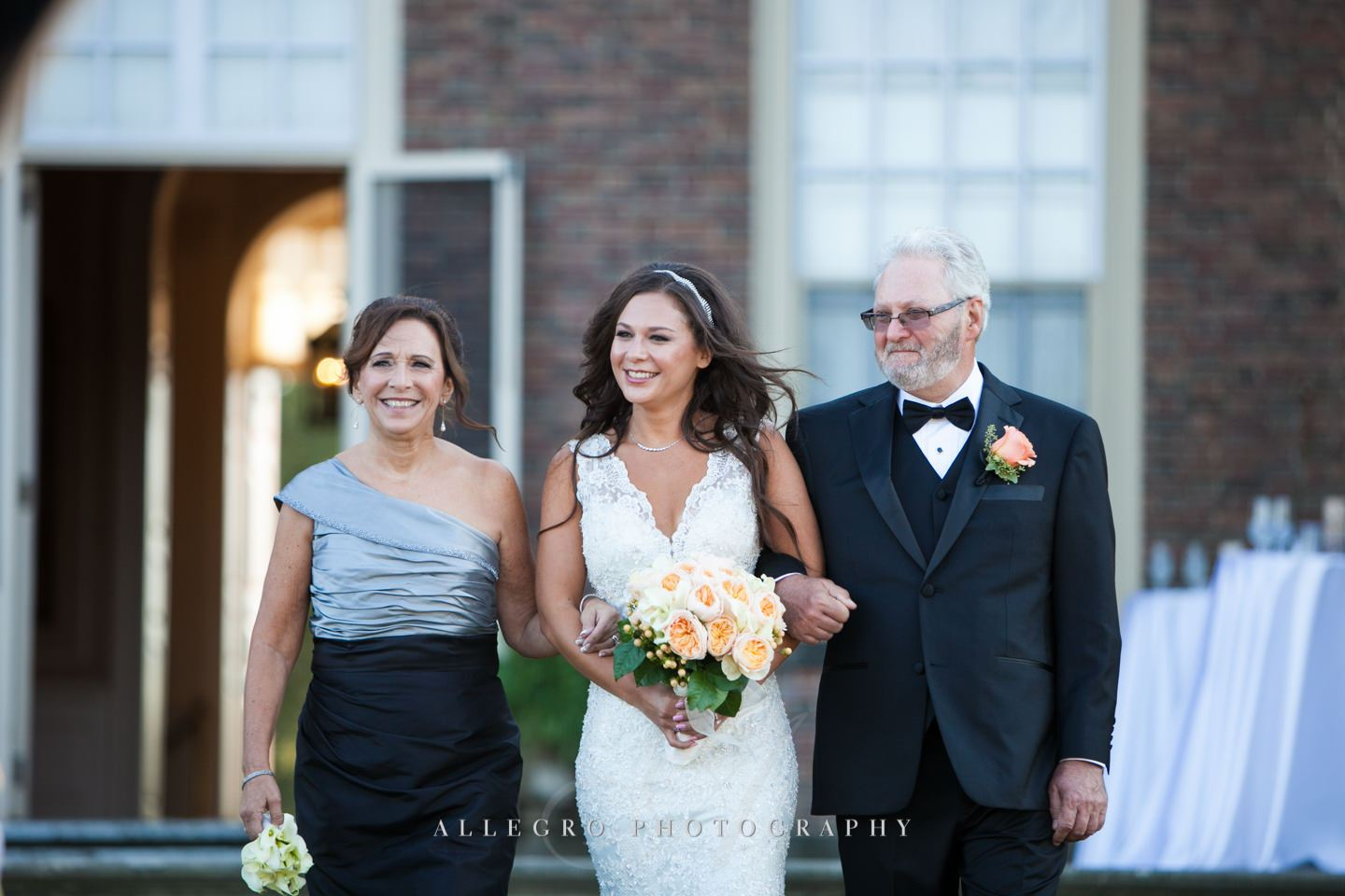 bride with her parents walking down the aisle- - photo by Allegro Photography