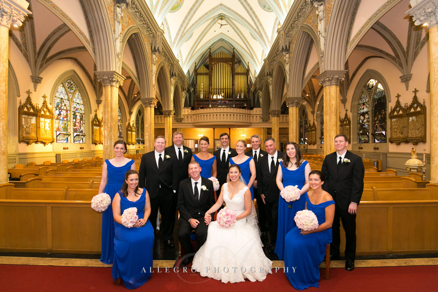 Our Lady of Victories Church formal portrait of wedding party- something different