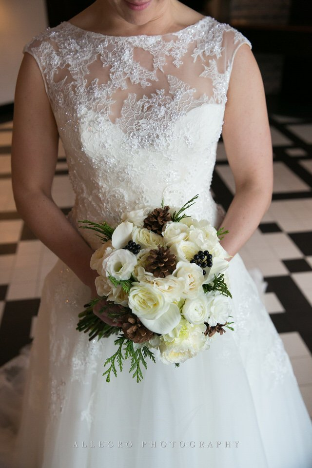 brides bouquet with white roses pinecones