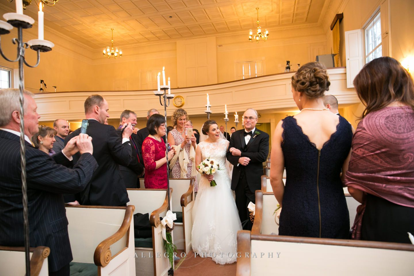 bride walks down aisle during wedding ceremony