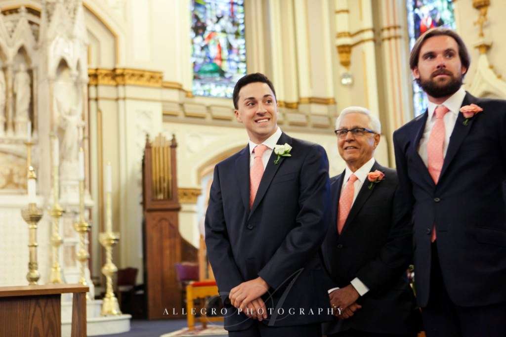 groom sees bride at church - photo by allegro photography