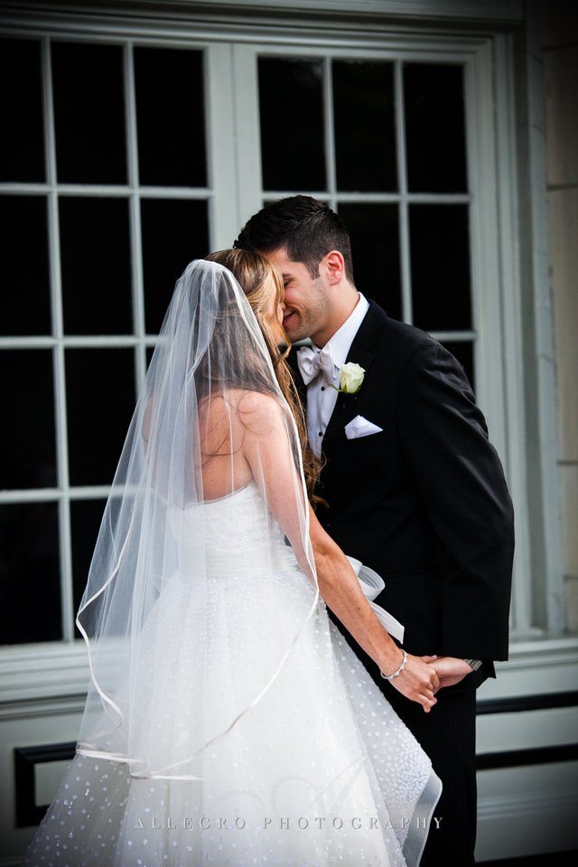 bride and groom kiss - photo by Allegro Photography