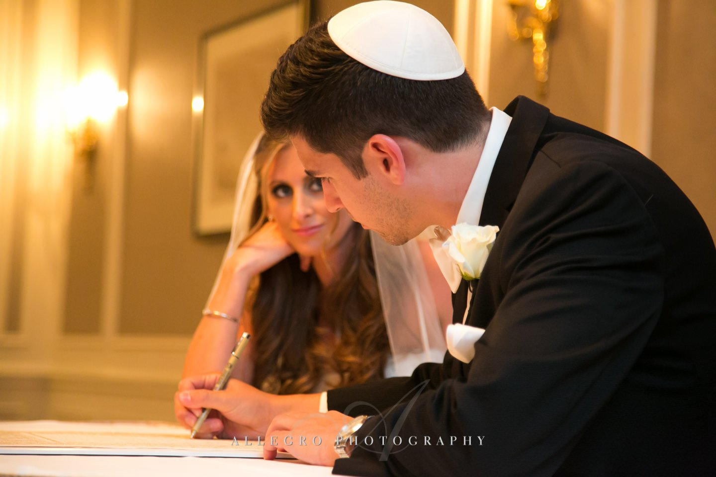 signing the ketubah - copley plaza boston- photo by allegro photography
