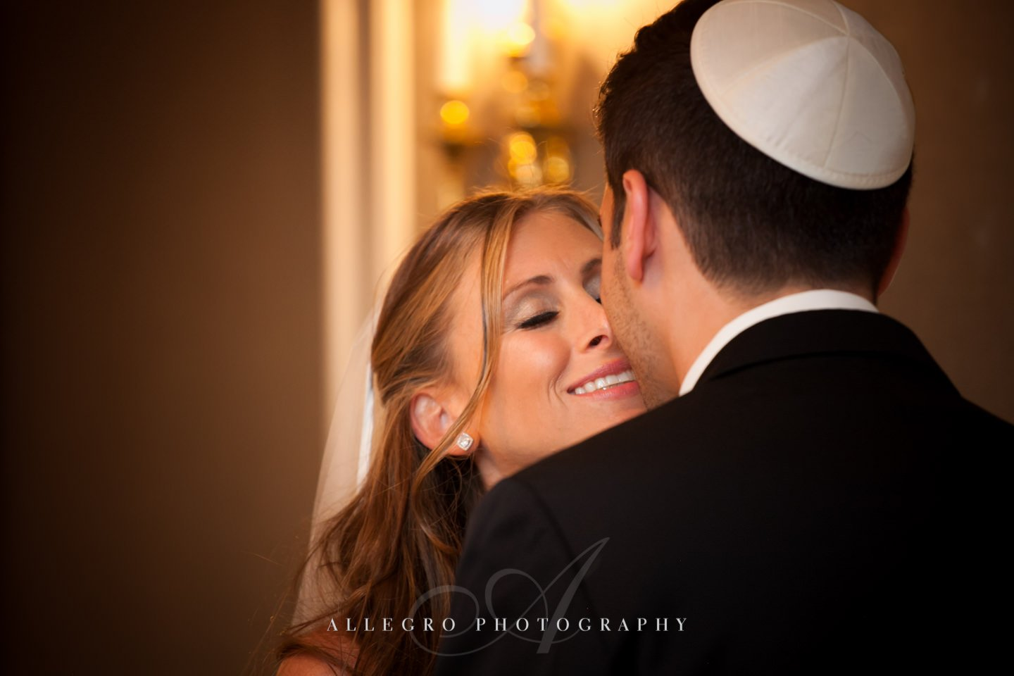 a sweet kiss post ketubah signing fairmont- copley plaza jewish wedding- photo by allegro photography