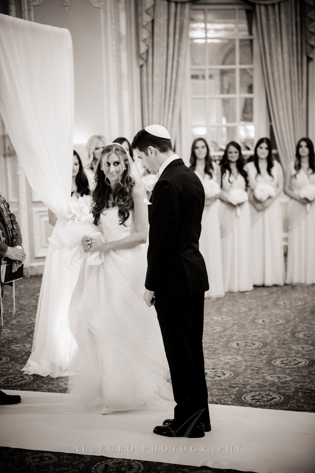bride circling groom seven times- jewish wedding in boston- photo by allegro photography