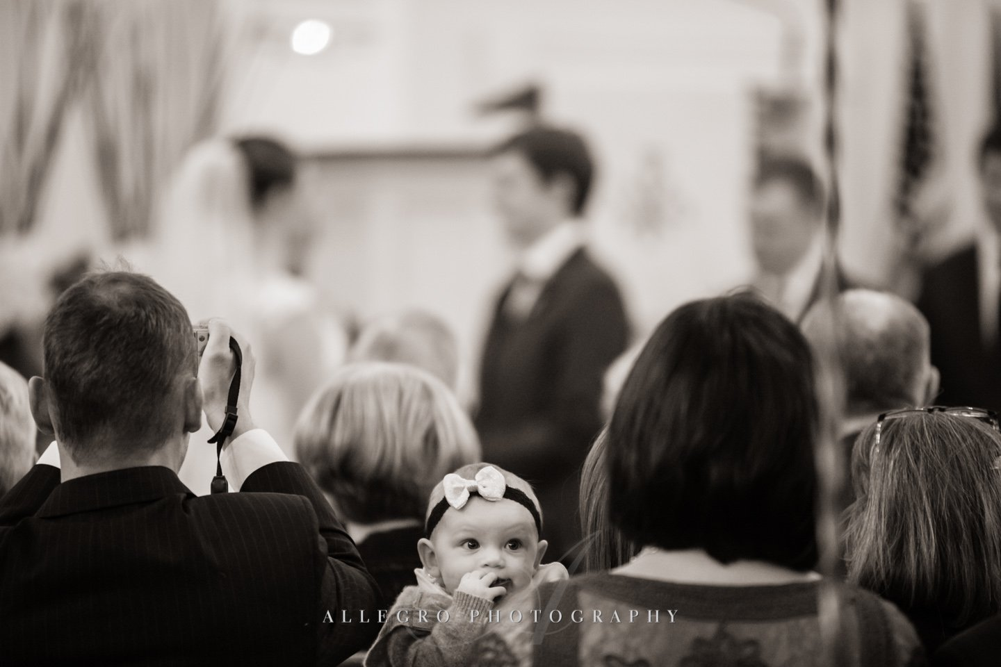 baby at wedding- photo by allegro photography