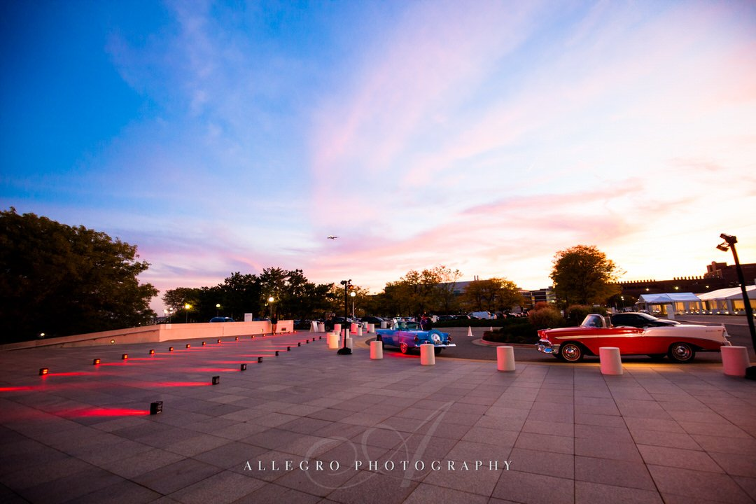 jfk library wedding - photo by Allegro Photography - sunset and classic cars- arrive in style