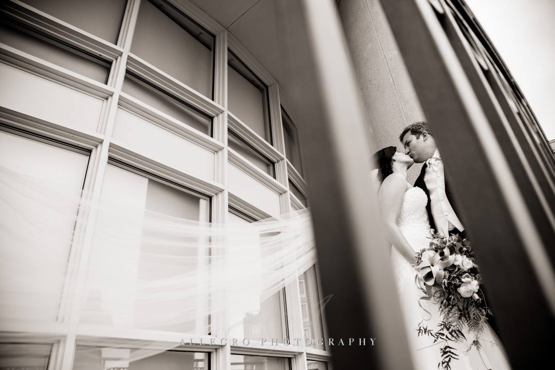 Boston bride and groom kiss, black and white - photo by allegro photography