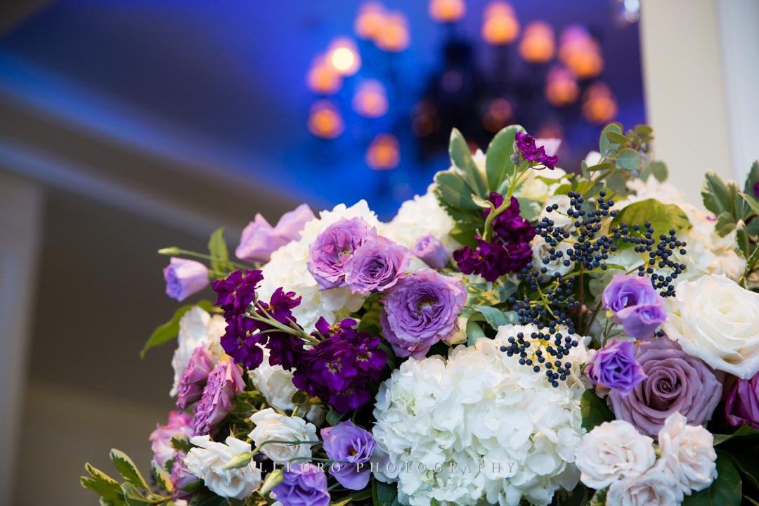 purple and white wedding bouquet - photo by allegro photography