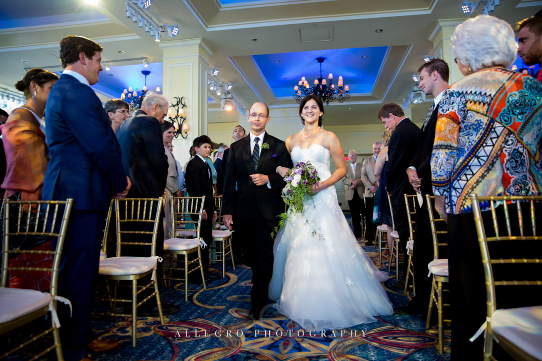 bride walking down the aisle - photo by allegro photography