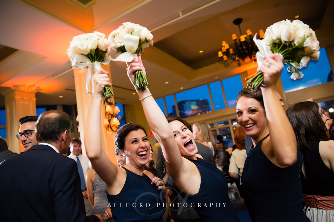 bridesmaids dancing at the boston harbor hotel - photo by allegro photography