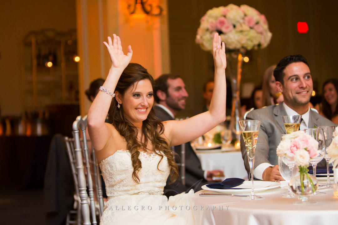 bride celebrating at the boston harbor hotel - photo by allegro photography