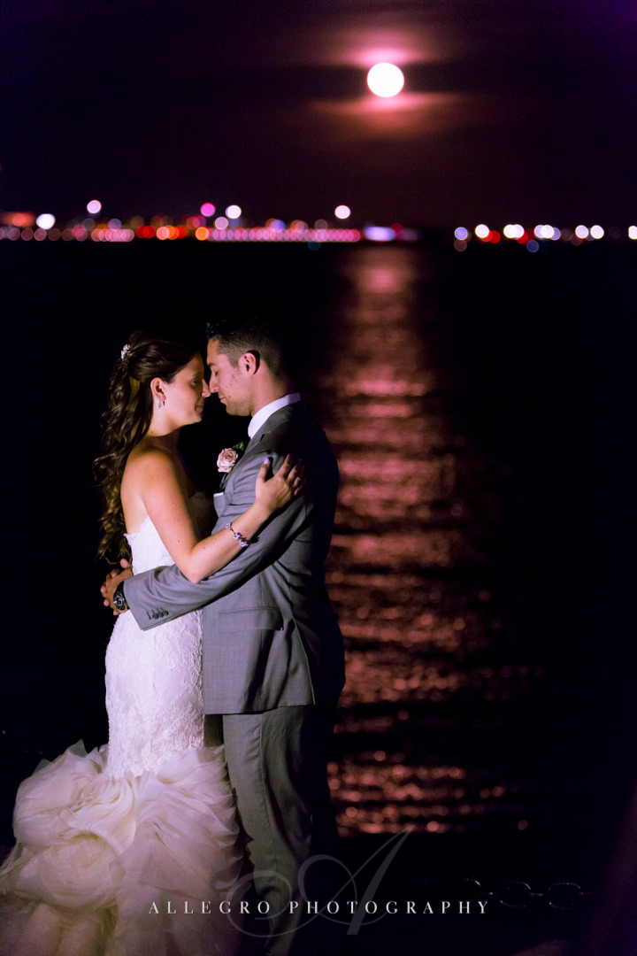 nighttime wedding portrait on the boston harbor - photo by allegro photography