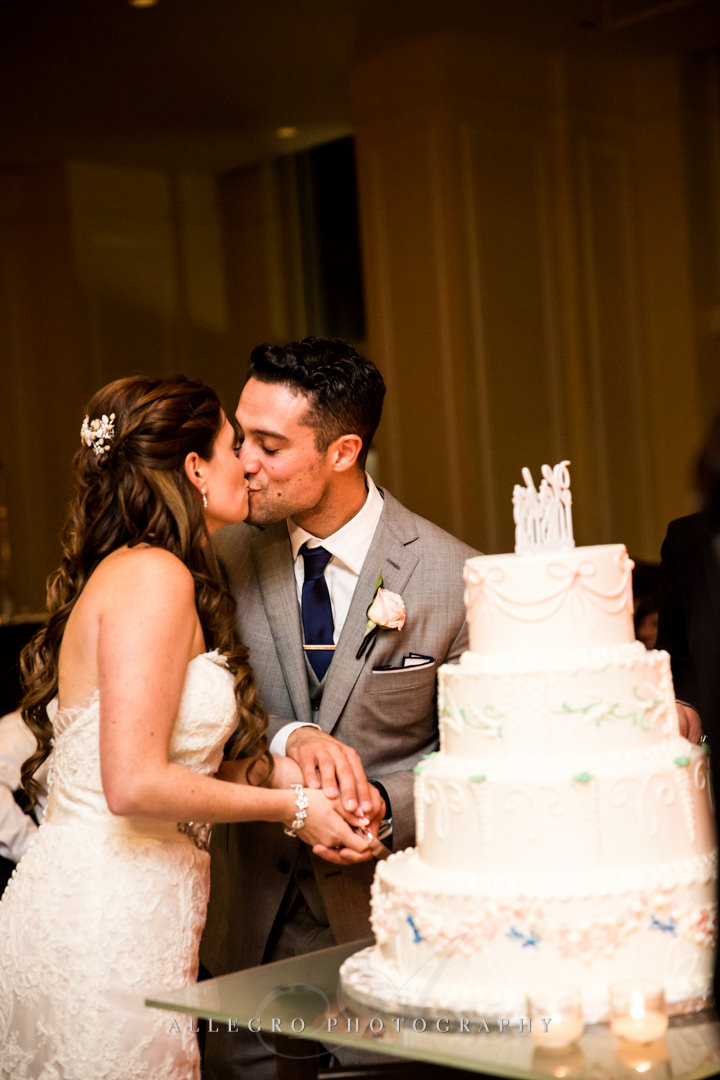 cutting the cake at the boston harbor hotel - photo by allegro photography