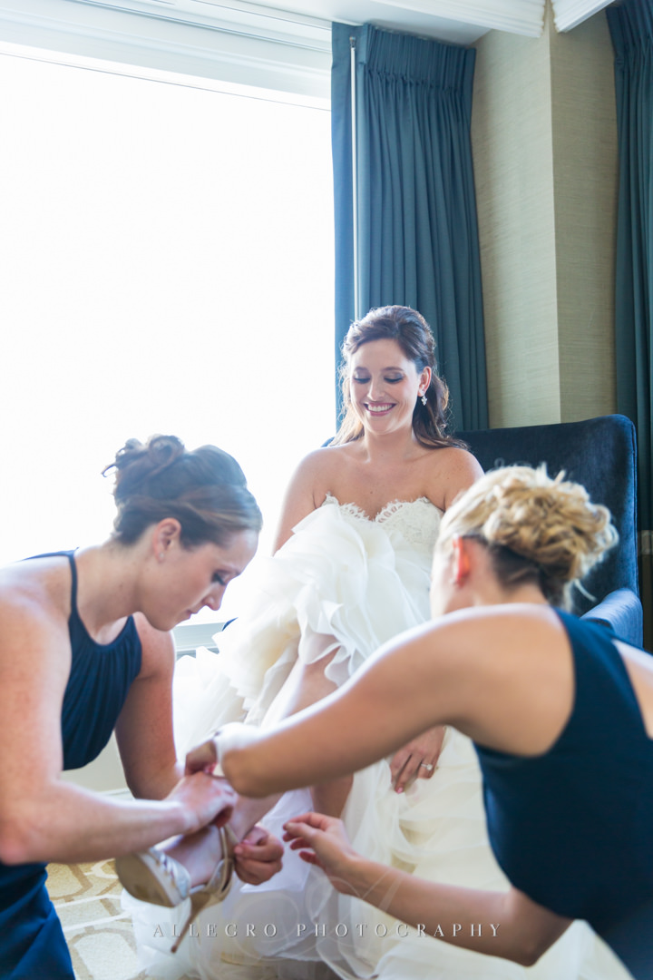 bridesmaids helping out at the boston harbor hotel - photo by allegro photography