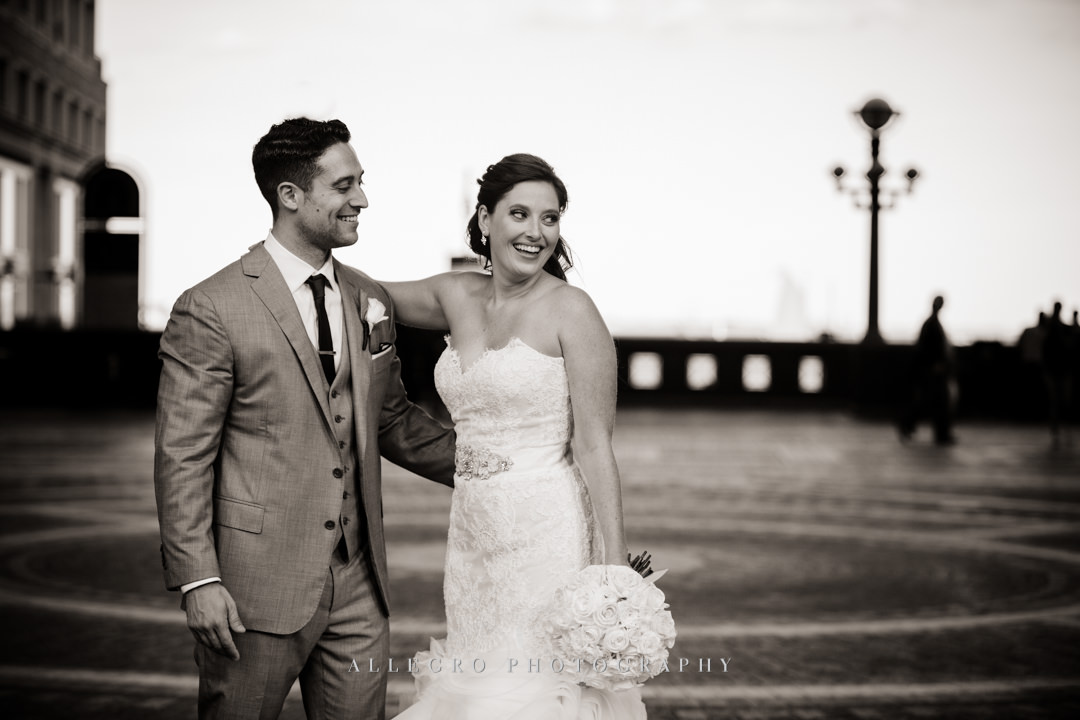 stunning bride and groom at the boston harbor - photo by allegro photography