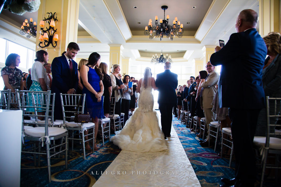 walking down the aisle at the boston harbor hotel - photo by allegro photography