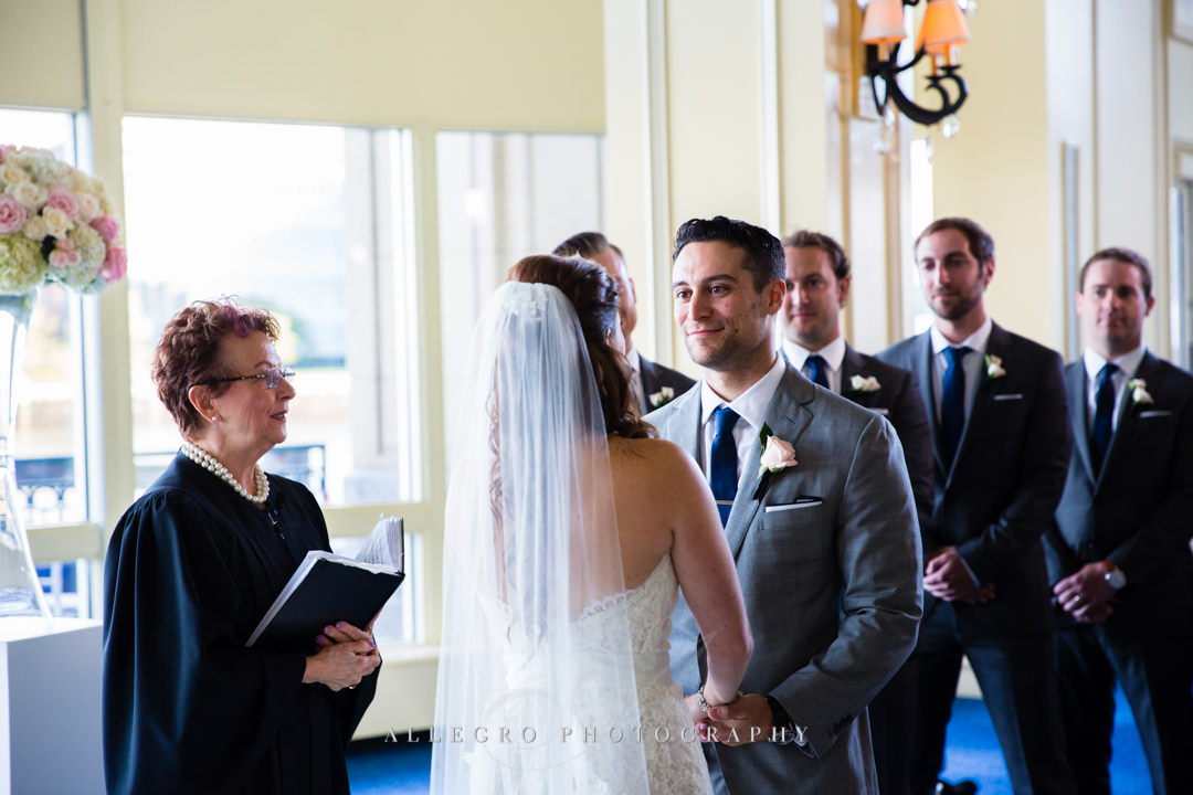 saying vows at the boston harbor hotel - photo by allegro photography