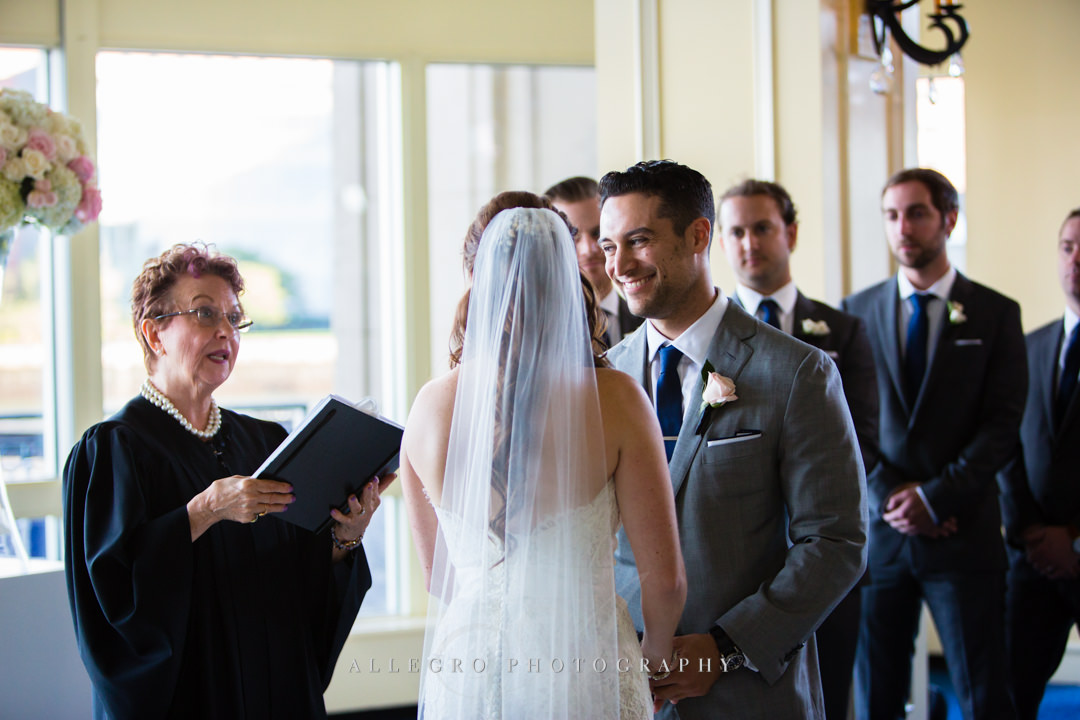 smiling groom at the boston harbor hotel - photo by allegro photography