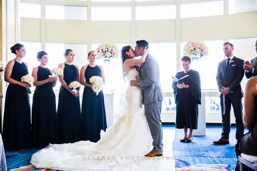 wedding kiss at the boston harbor hotel - photo by allegro photography