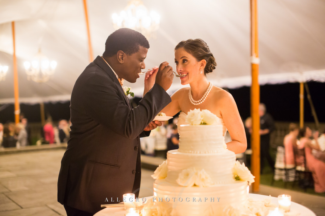 first bite of the wedding cake at crane estate - photo by allegro photography