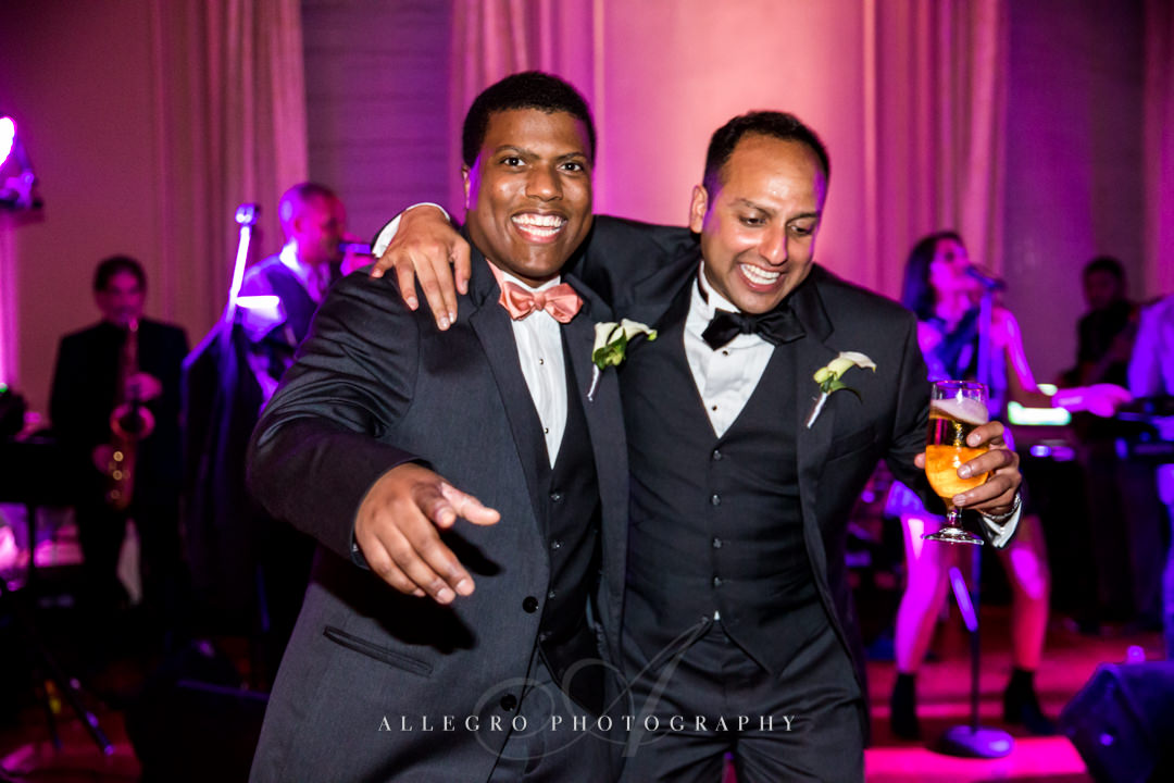 groom dancing at wedding reception at the crane estate - photo by allegro photography