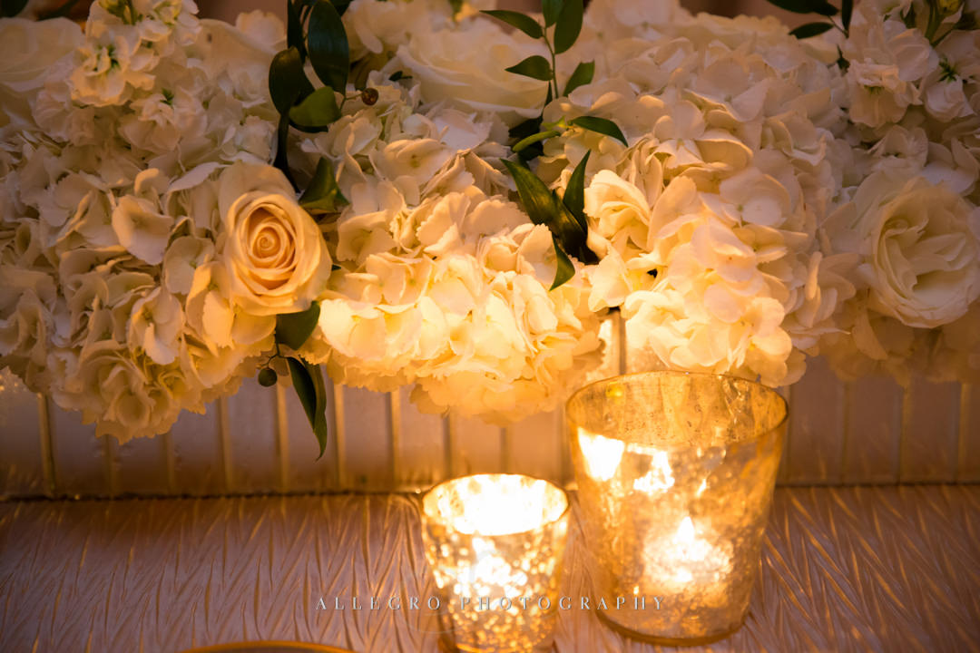 moo restaurant wedding flowers and tea lights - photo by allegro photography